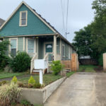 5018-NE-Grand–front-house-and-driveway